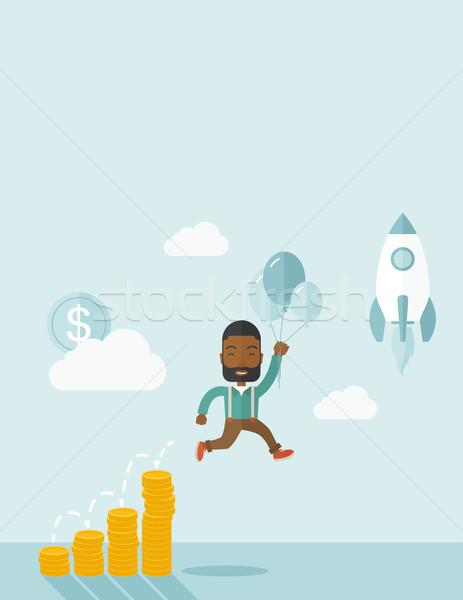 African businessman holding balloons. Stock photo © RAStudio
