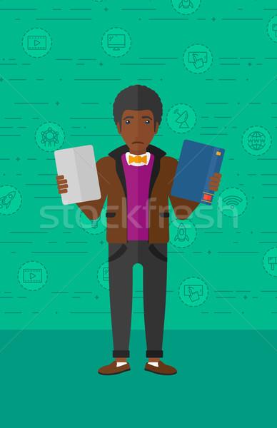 Férfi választ könyv táblagép zavart papír Stock fotó © RAStudio