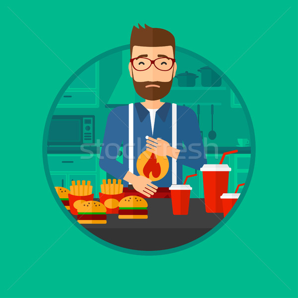 Man lijden maagzuur permanente keukentafel Stockfoto © RAStudio