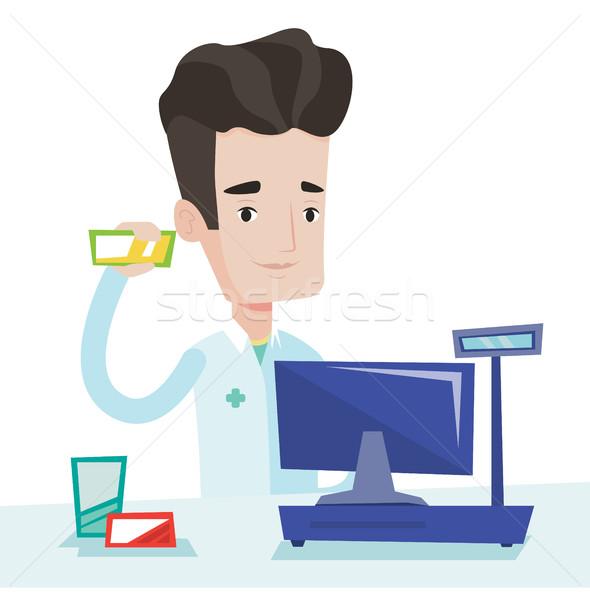 Pharmacist showing some medicine. Stock photo © RAStudio