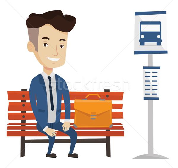 Businessman waiting for bus at the bus stop. Stock photo © RAStudio