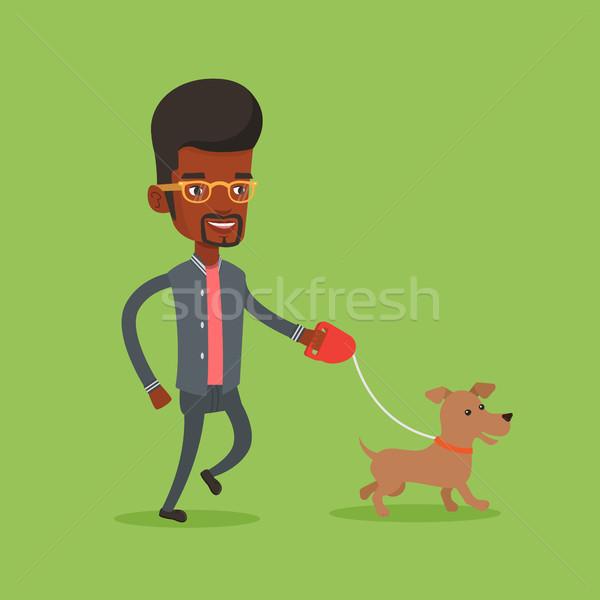 Jeune homme marche chien animal heureux homme Photo stock © RAStudio