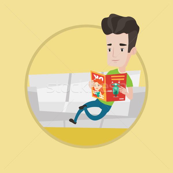 Stock photo: Man reading magazine on sofa vector illustration.