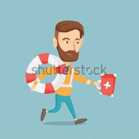 Paramedicus lopen eerste hulp vak jonge asian Stockfoto © RAStudio
