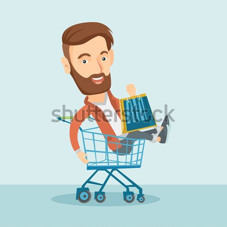 Happy woman riding by shopping trolley. Stock photo © RAStudio
