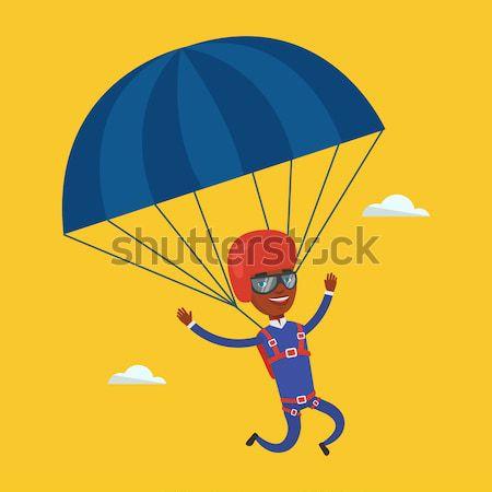 молодые счастливым человека Flying парашютом Сток-фото © RAStudio