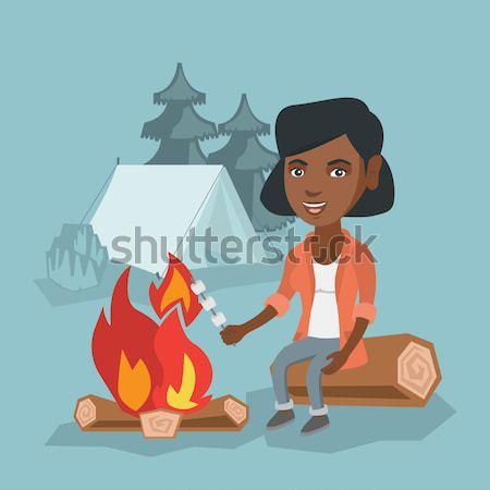 Kadın oturma kamp ateşi kamp seyahat Stok fotoğraf © RAStudio