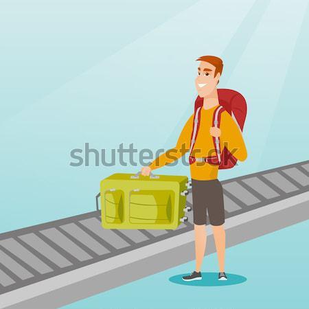 Mujer hasta maleta equipaje cinturón Foto stock © RAStudio