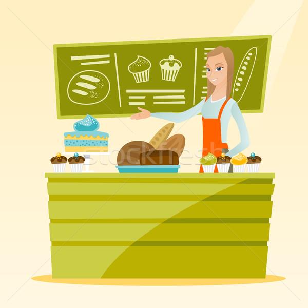 Munkás áll mögött pult pékség kaukázusi Stock fotó © RAStudio