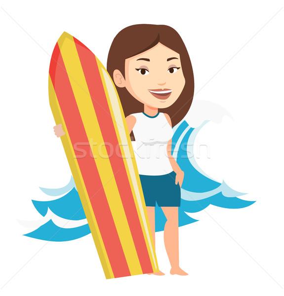 Szörfös tart szörfdeszka nő áll tengerpart Stock fotó © RAStudio