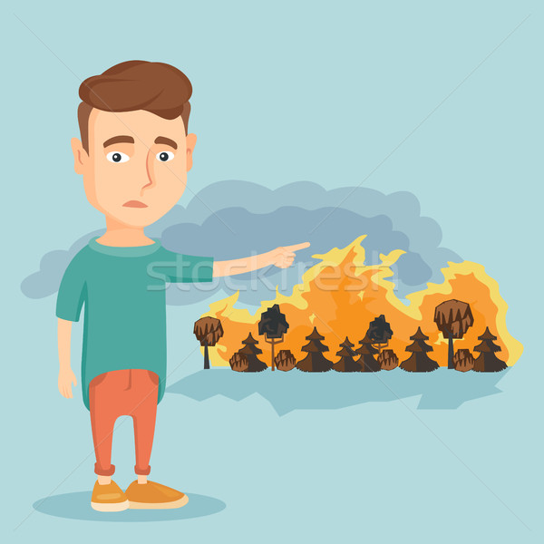 Man standing on the background of wildfire. Stock photo © RAStudio