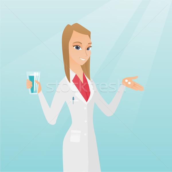 Farmacéutico pastillas vidrio agua jóvenes caucásico Foto stock © RAStudio