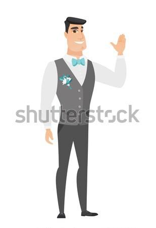 Asian businessman showing stop hand gesture. Stock photo © RAStudio