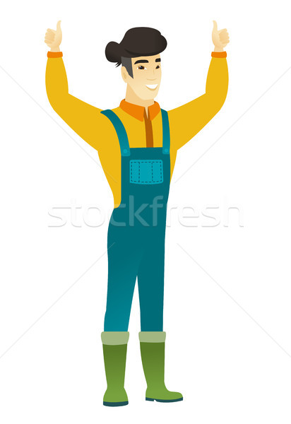 Farmer standing with raised arms up. Stock photo © RAStudio