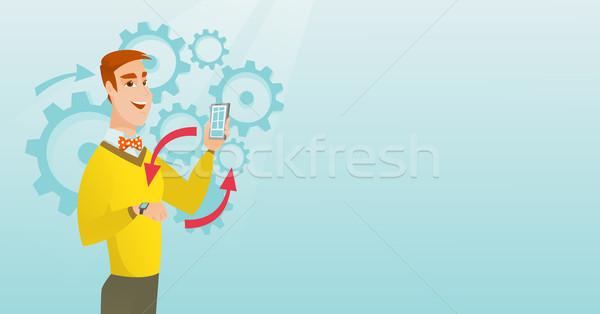 Synchronization between smartwatch and smartphone. Stock photo © RAStudio