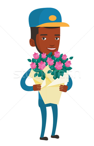 Delivery courier holding bouquet of flowers. Stock photo © RAStudio