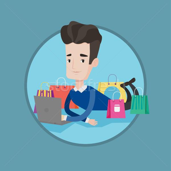 Adam alışveriş çevrimiçi genç kafkas dizüstü bilgisayar kullanıyorsanız Stok fotoğraf © RAStudio