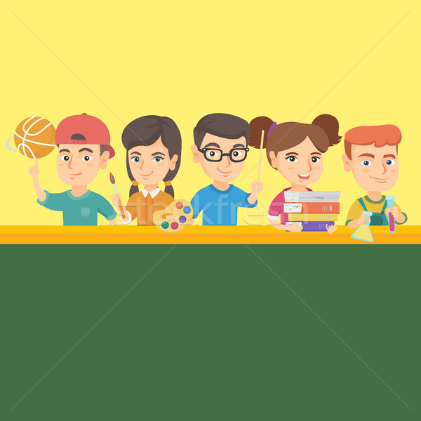 Kids standing at the table with school supplies. Stock photo © RAStudio