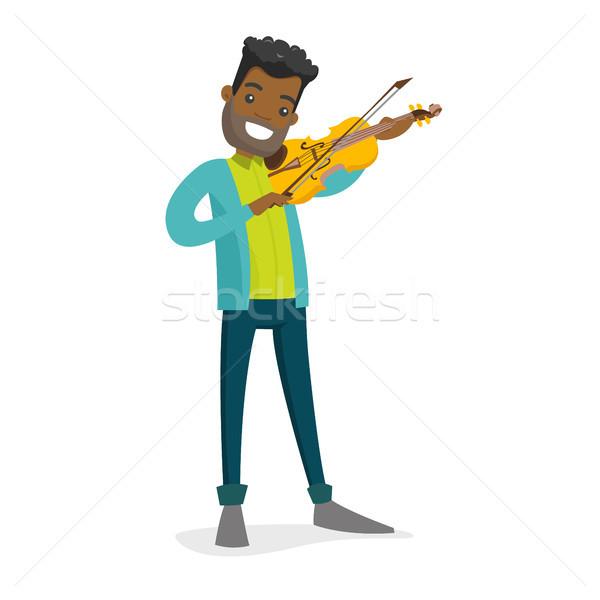 Сток-фото: молодые · человека · играет · скрипки · улыбаясь · музыканта