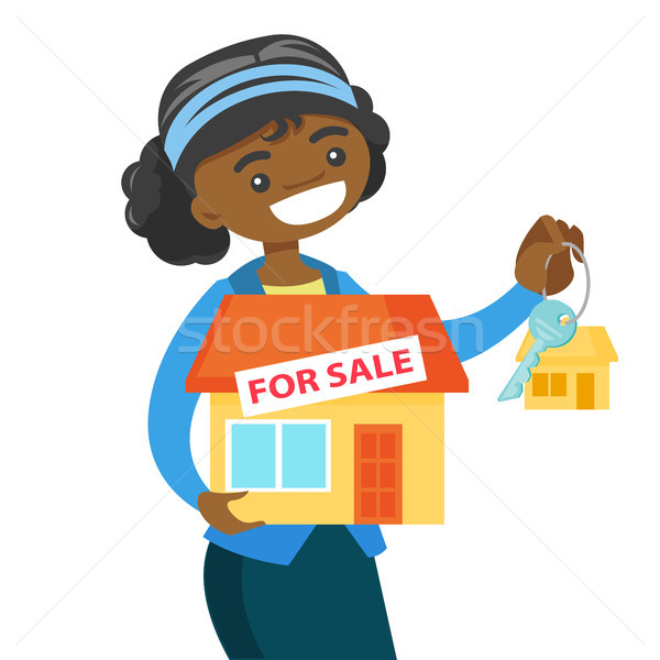 African-american real estate agent holding key. Stock photo © RAStudio