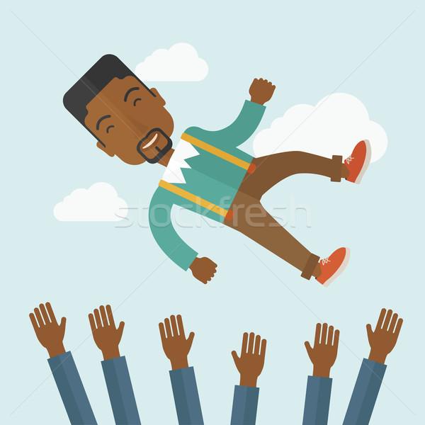 Happy african-american businessman. Stock photo © RAStudio