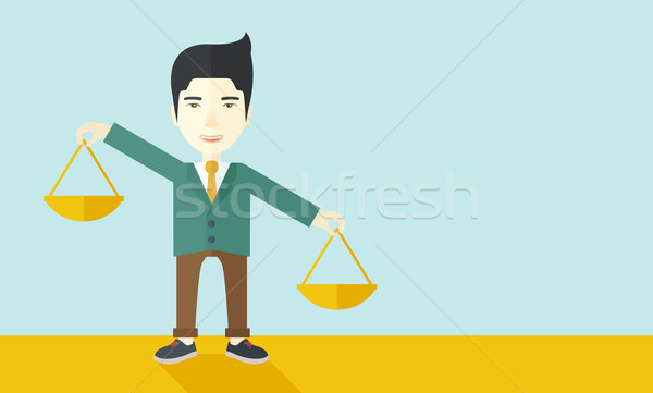 Japanese man holding a weighing scale. Stock photo © RAStudio