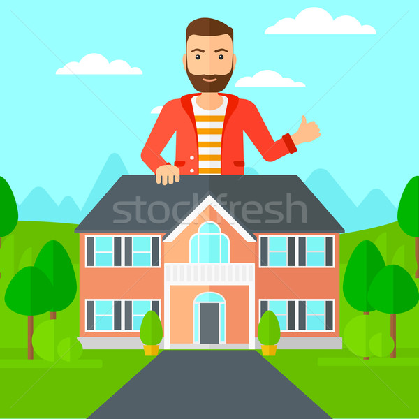 Real estate agent showing thumb up. Stock photo © RAStudio