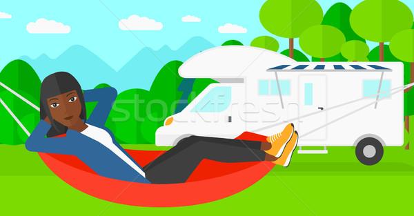 Woman lying in hammock. Stock photo © RAStudio