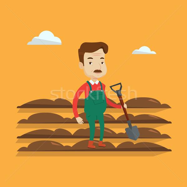 Farmer with shovel at field vector illustration. Stock photo © RAStudio