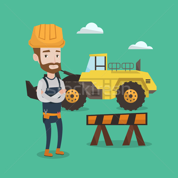 Confident builder with arms crossed. Stock photo © RAStudio
