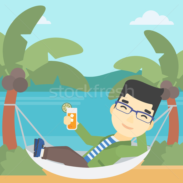 Man chilling in hammock with cocktail. Stock photo © RAStudio