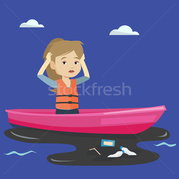Woman floating in a boat in polluted water. Stock photo © RAStudio