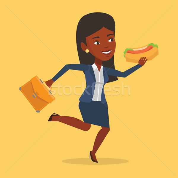 Iş kadını yeme sosisli sandviç acele evrak çantası çalıştırmak Stok fotoğraf © RAStudio