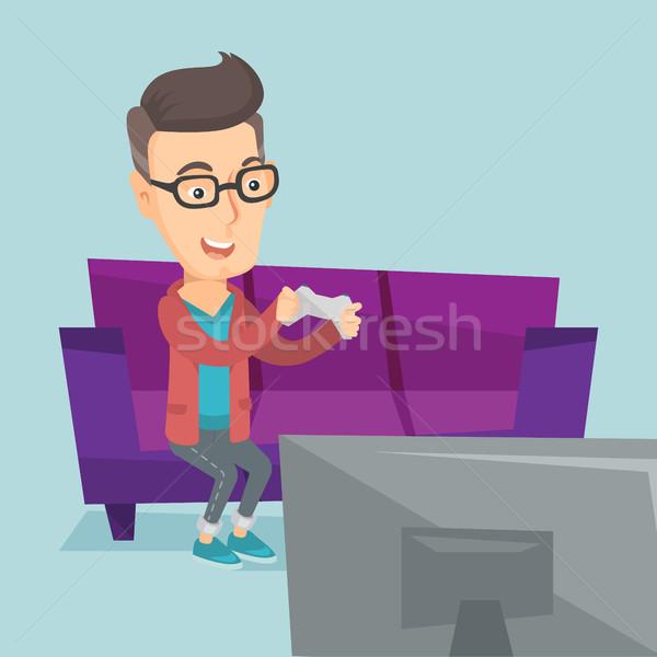 Homme jouer jeu vidéo heureux séance Photo stock © RAStudio