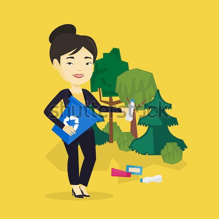 Woman collecting garbage in forest. Stock photo © RAStudio