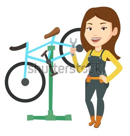 Asian rower mechanik pracy naprawy sklep Zdjęcia stock © RAStudio