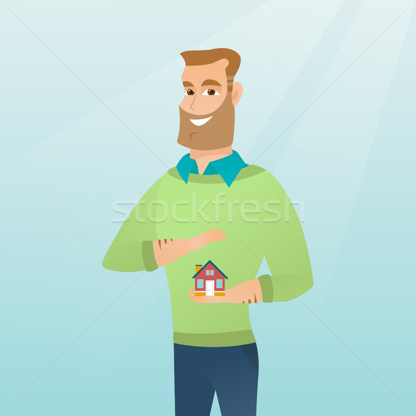 Insurance agent protecting model of house. Stock photo © RAStudio