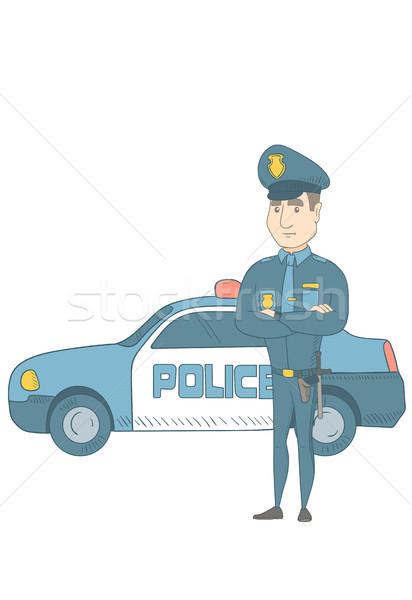Police officer standing in front of police car. Stock photo © RAStudio