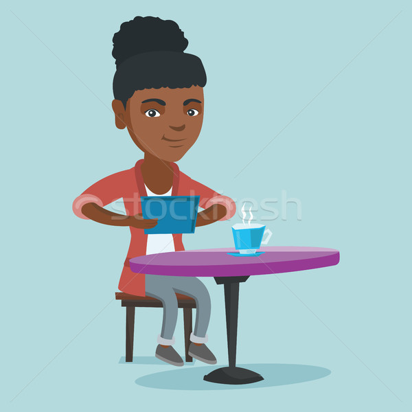 Woman surfing in the social network in the cafe. Stock photo © RAStudio