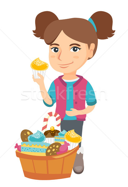 Girl holding a cupcake and stroking her belly. Stock photo © RAStudio