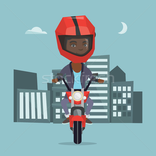 Young african woman riding a motorcycle at night. Stock photo © RAStudio