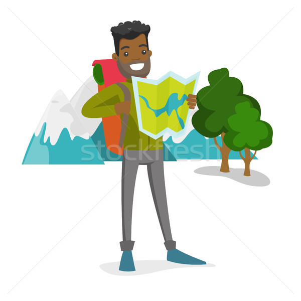 African traveler with backpack looking at map. Stock photo © RAStudio