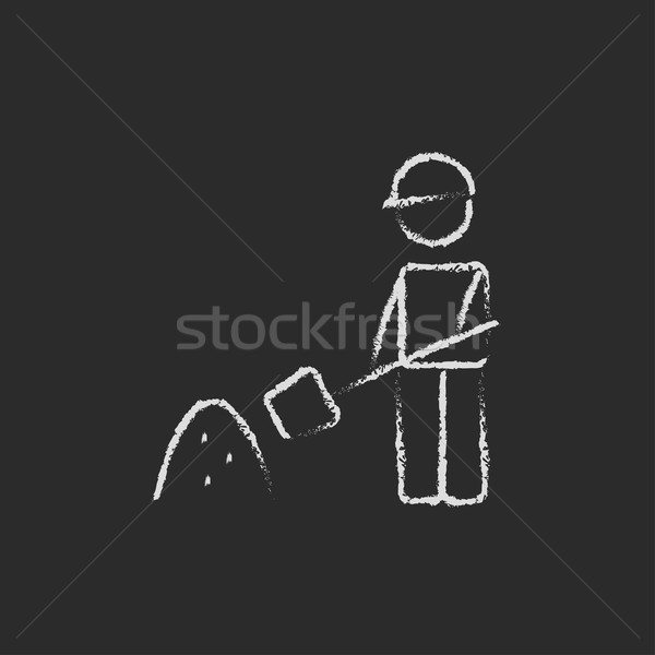 Stock photo: Man with shovel and sand icon drawn in chalk.