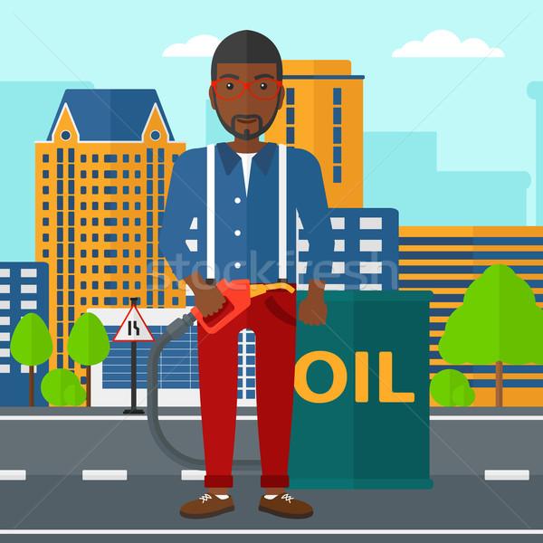 Homme pétrolières peuvent remplissage buse permanent Photo stock © RAStudio