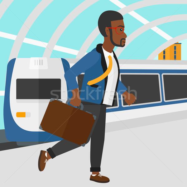 Man going out of train. Stock photo © RAStudio