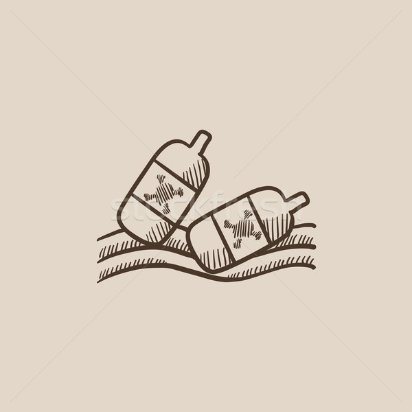 Bottles floating in water sketch icon. Stock photo © RAStudio