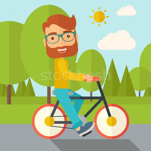Man riding a bicycle. Stock photo © RAStudio