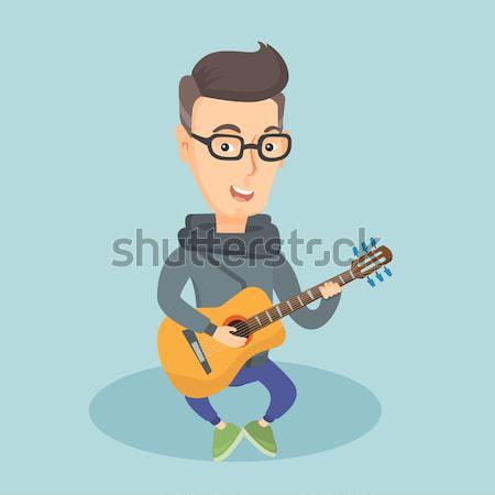 男 演奏 ミュージシャン 座って ギター ストックフォト © RAStudio