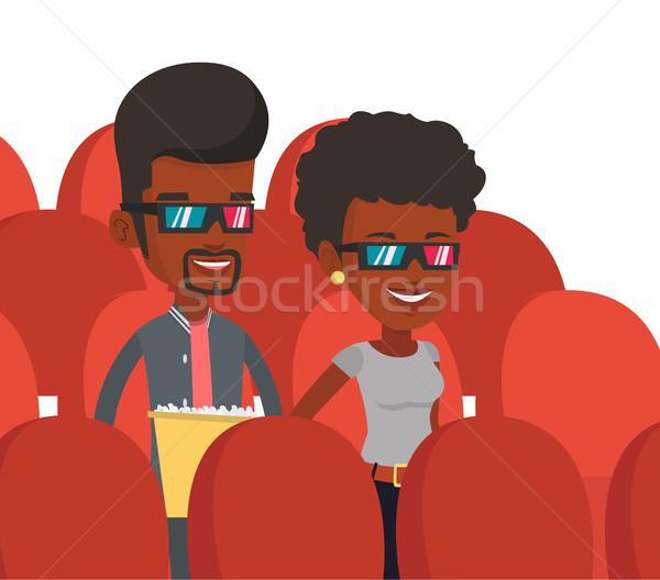 Happy friends watching 3D movie in the theatre. Stock photo © RAStudio