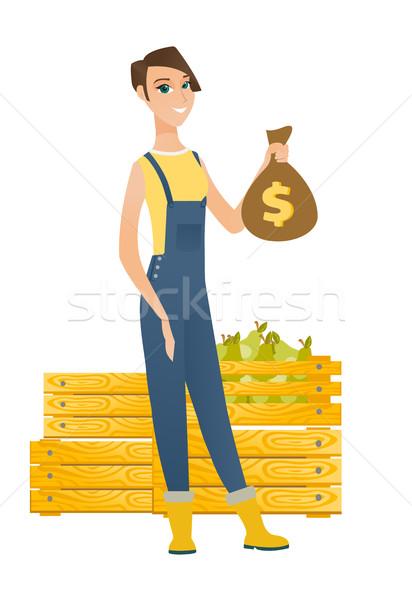 Kaukázusi gazda tart pénz táska mutat Stock fotó © RAStudio